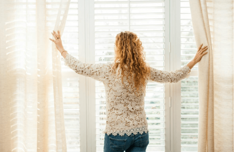 a girl and curtains
