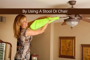 Girl cleaning ceiling fan